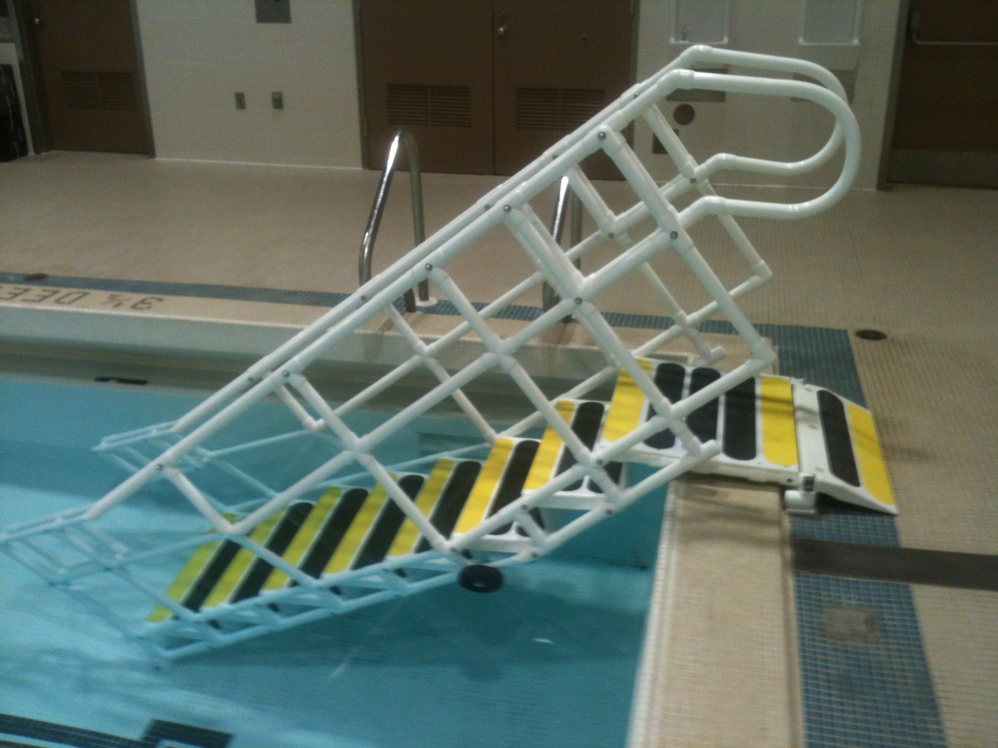 Rehab systems llc aquatrek ada step system - Above ground pool steps for handicap ...